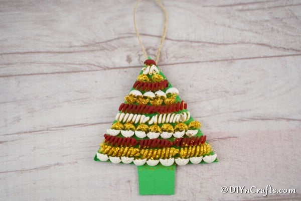 A simple pasta christmas tree laying on a wooden table