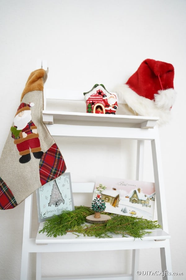 A miniature pine cone ornament displayed on a white shelf