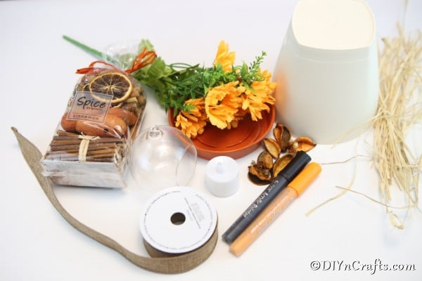 Supplies for making a scarecrow lantern out of a clay pot