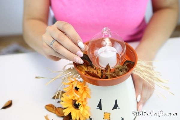 Adding a candle and bowl to the top of your scarecrow clay pot