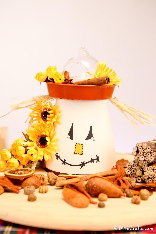 Clay pot lantern on wooden platter