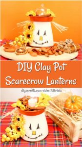 DIY scarecrow clay pot lantern sitting on a cloth with orange background