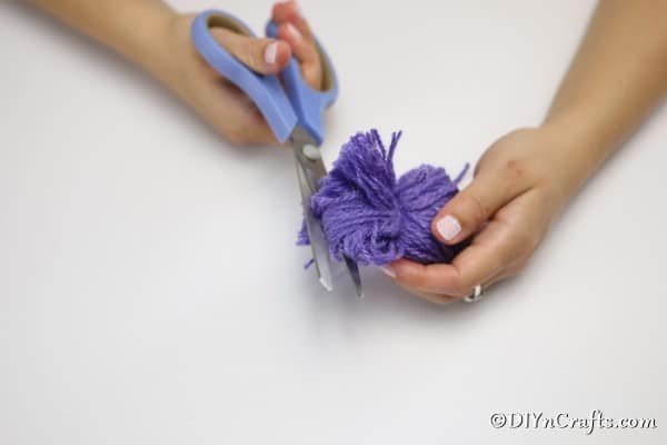 Cutting the ends of yarn to create a flower