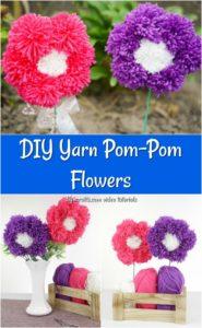 yarn pom pom flowers in a white vase displayed