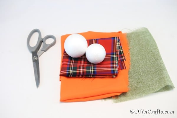 Supplies needed for making a cloth pumpkin ornament as fall decor