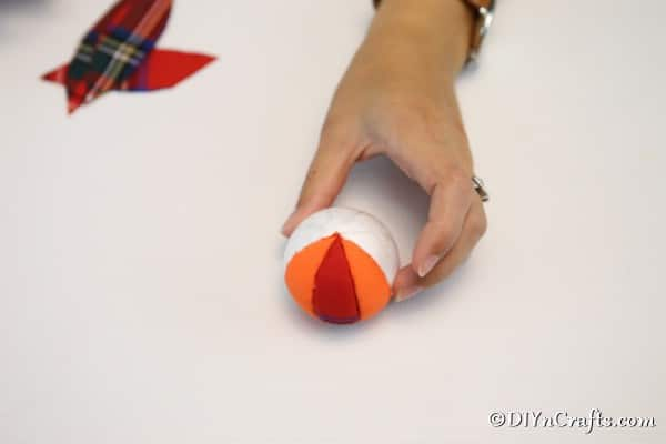 Adding the fabric to the pumpkin ornament craft