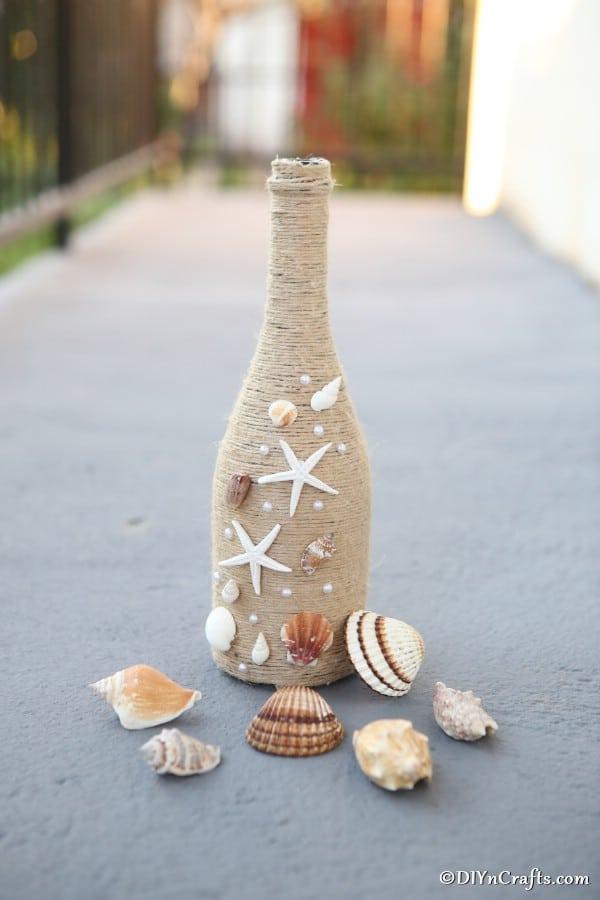 Wine bottle decor rustic nautical piece on a concrete walkway
