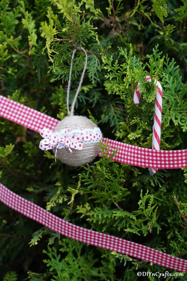 Rustic Christmas ornaments hanging on a holiday tree