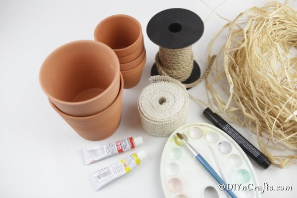 Supplies for making flower pot people into scarecrows