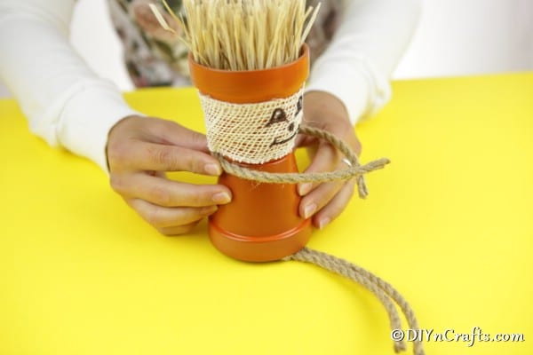 Adding arms and legs ropes to the flower pot people scarecrow