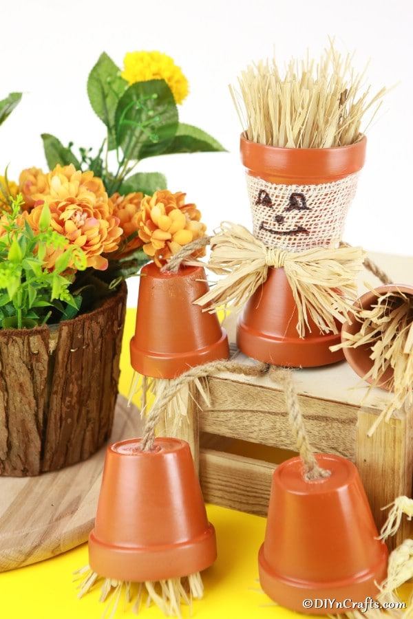 Up close picture of a complete scarecrow flower pot people craft
