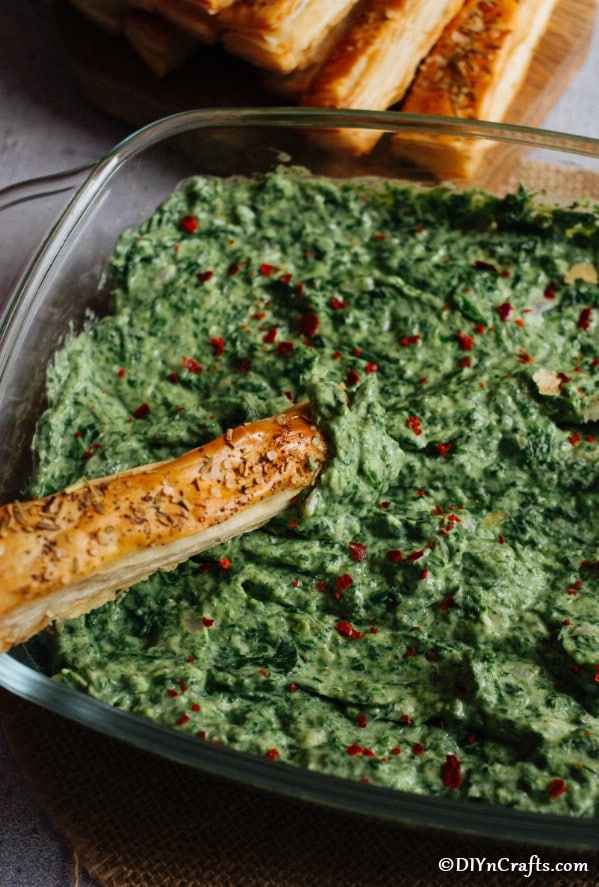 Up close picture of a large bowl filled with hot spinach dip