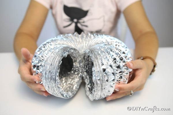Cutting dryer vent pipe to correct size for pumpkin decor