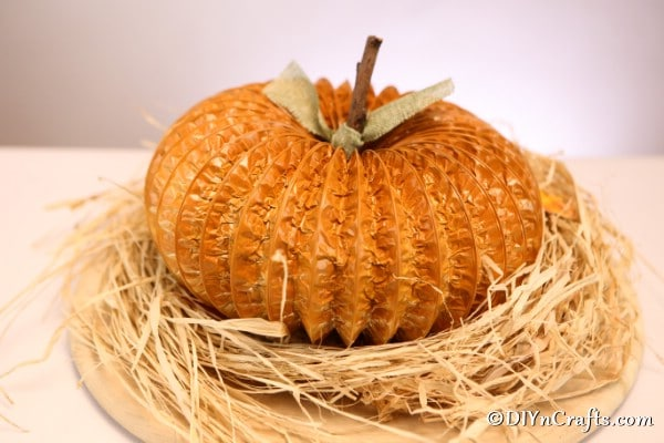 A completed dryer vent pipe pumpkin decor idea