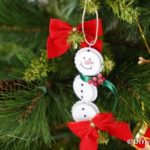 Up close bottle cap snowman ornaments on the tree