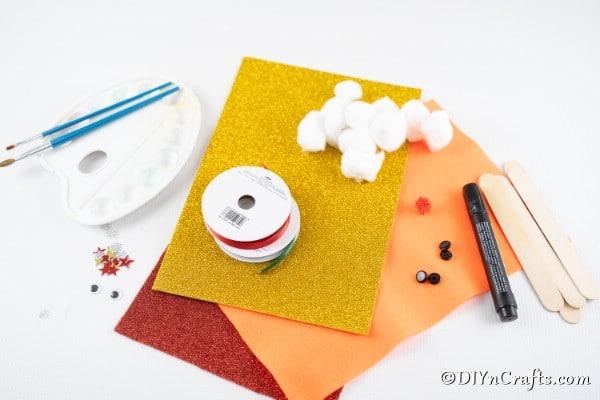 Supplies needed for making craft stick Christmas tree ornaments