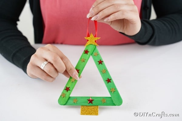A completed christmas tree craft stick ornament