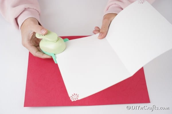Folding and adding punches to the white card