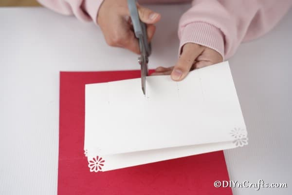 Cutting lines to create gift boxes on the 3D Christmas card