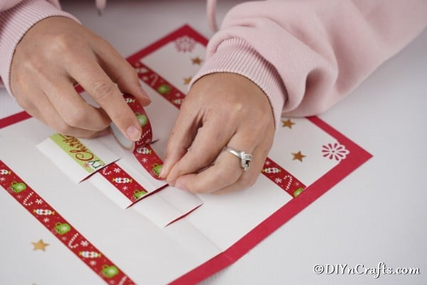 Decorating the gift boxes on a 3D Christmas card with washi tape