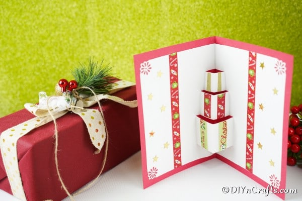 A 3D christmas card displayed in front of green background
