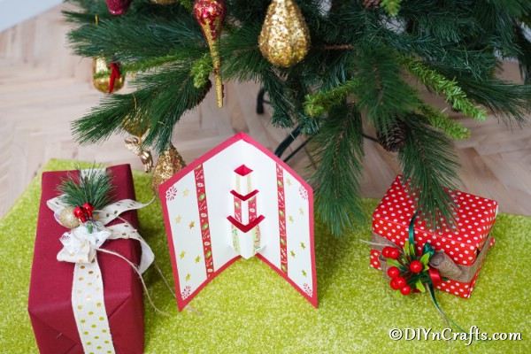 3D Christmas Card under Christmas tree with presents
