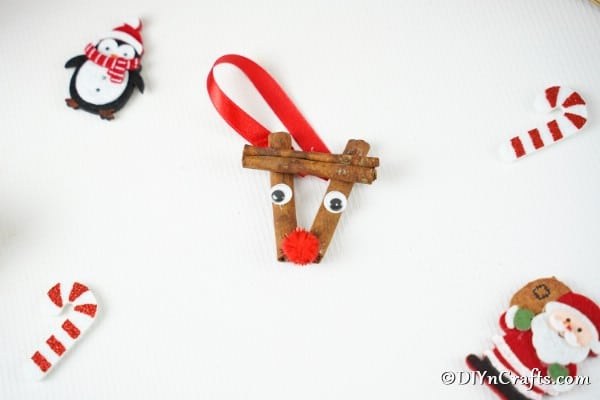 Cinnamon stick reindeer ornaments on a white table