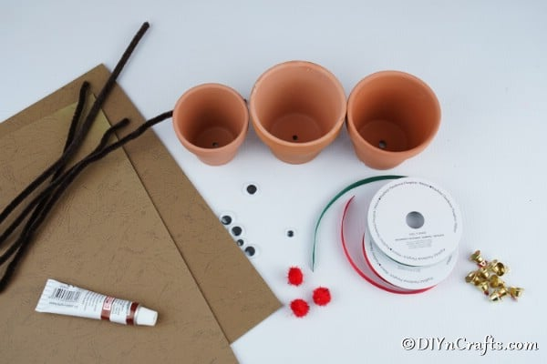 Supplies needed to make a clay pot reindeer christmas decoration