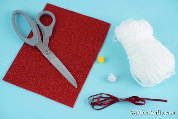 Supplies needed for making a Christmas gnome ornament