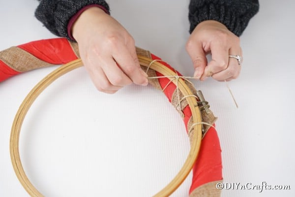 Attaching a second wooden frame to the middle of the rustic diy Christmas wreath