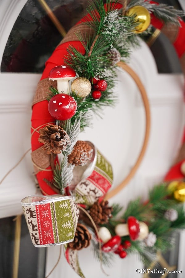 Up close picture of a rustic Christmas wreath hanging on a front door