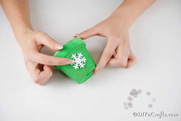 Gluing snowflake to flower pot bell