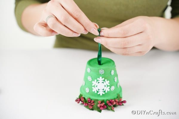 Adding the ribbon and bells to the Christmas bell decoration