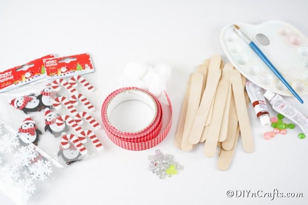 Supplies needed to make a gingerbread house craft stick ornament