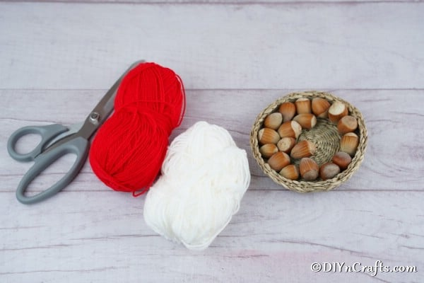 Supplies needed for making a rustic hazelnut Christmas ornament wreath