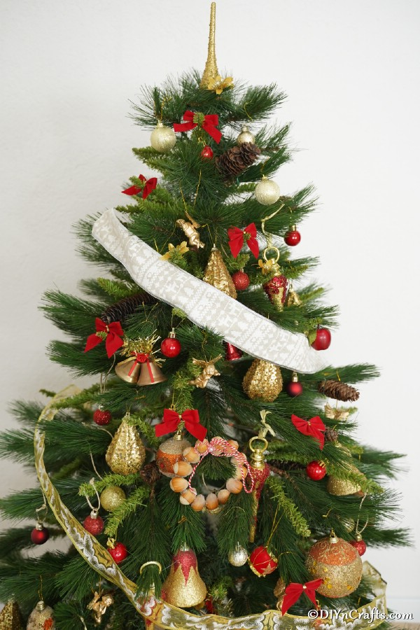 A Christmas tree featuring a rustic hazelnut Christmas decoration