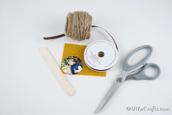 Supplies needed to make a lollipop photo ornament