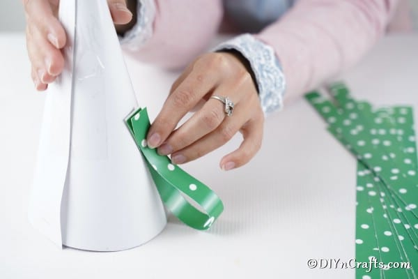 Gluing paper loops to the mini Christmas tree