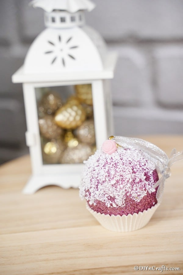 Cupcake ornament Christmas tree ornament in front of a white lantern