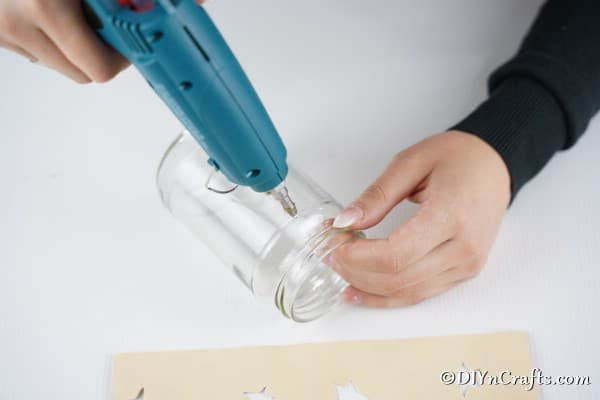 Adding glue to the jar for holding sheet music in place