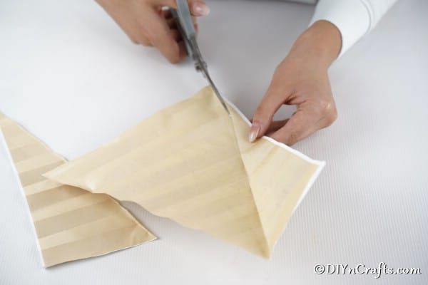 Cutting a piece of sheet music into a tree shape