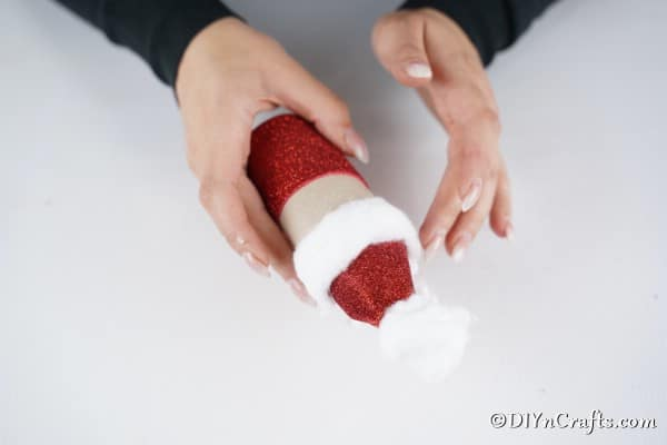 Adding the cotton to create santa hair