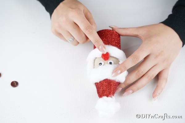 Adding the face to Santa toiler paper roll craft