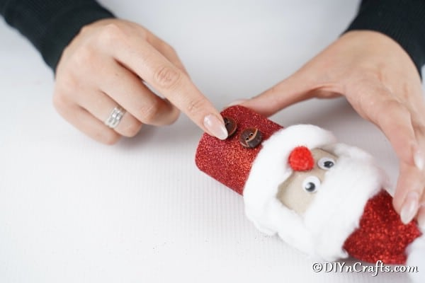 Adding buttons to the toilet paper roll Santa