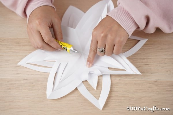 Layering paper cutouts for 3D snowflake or star