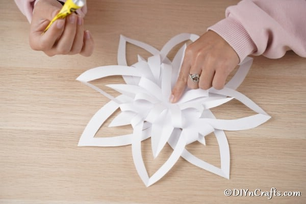 Gluing paper together to make a floral paper star