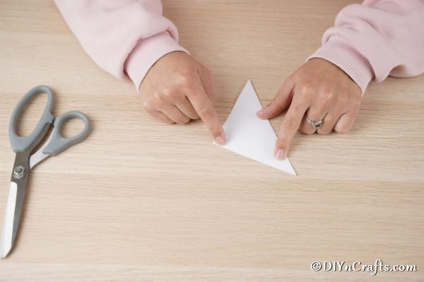Folding paper to make 3D snowflake or paper stars
