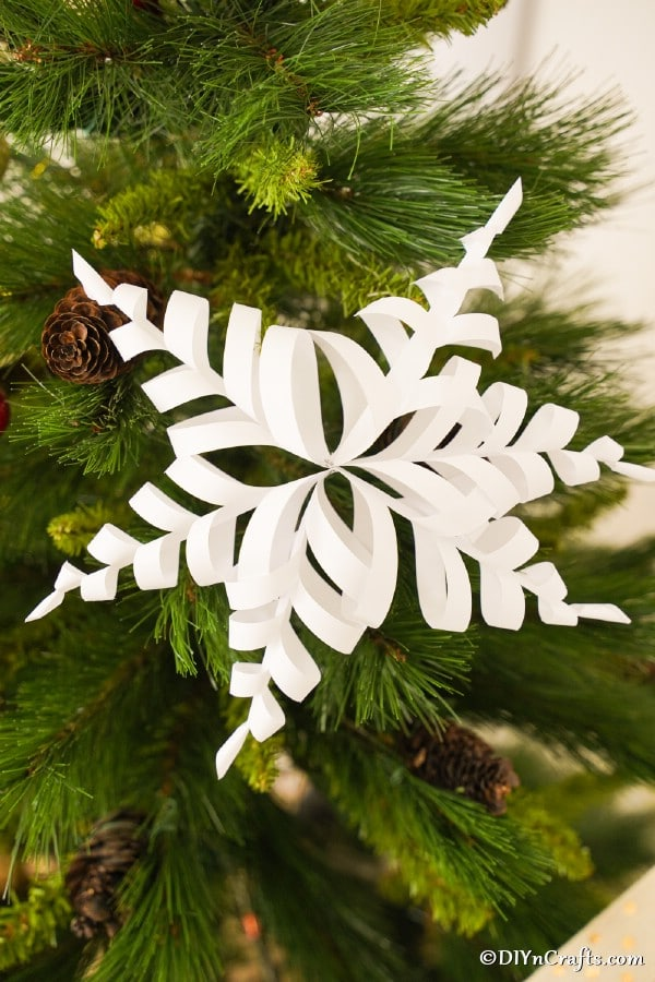 A paper snowflake on a Christmas tree