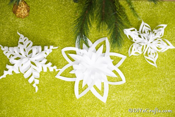 3d paper snowflakes on a green surface