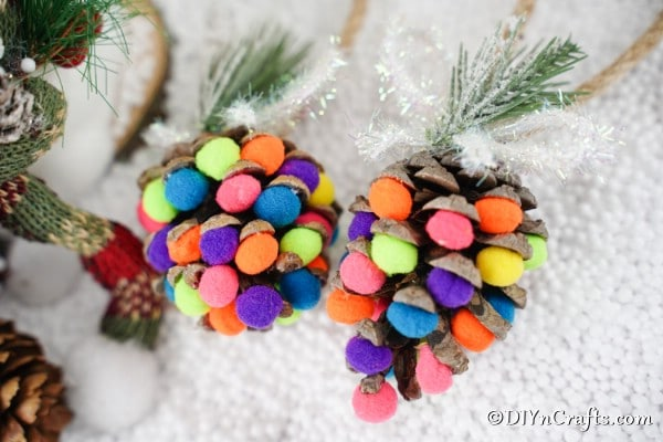 Pinecone ornaments displayed against a white background